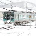 写真: 雪の中の125系。
