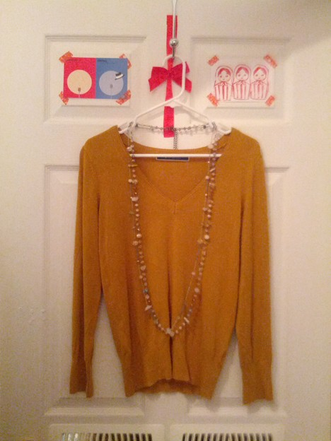 #1-knit sweater from THE EMPORIUM.($15-)