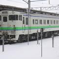 雪に佇む気動車